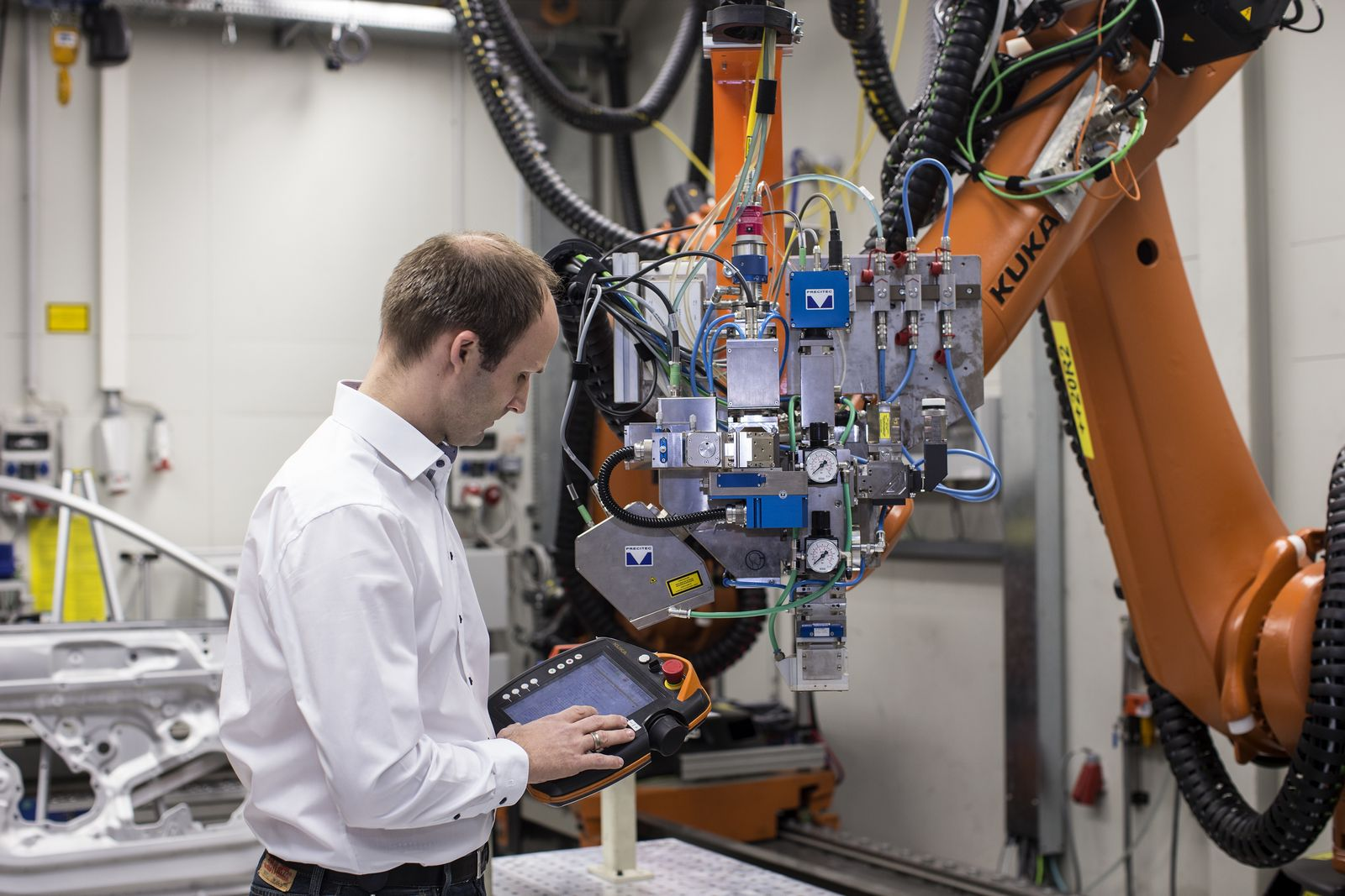 Jan Philipp Weberpals controlling the remote laser welding system