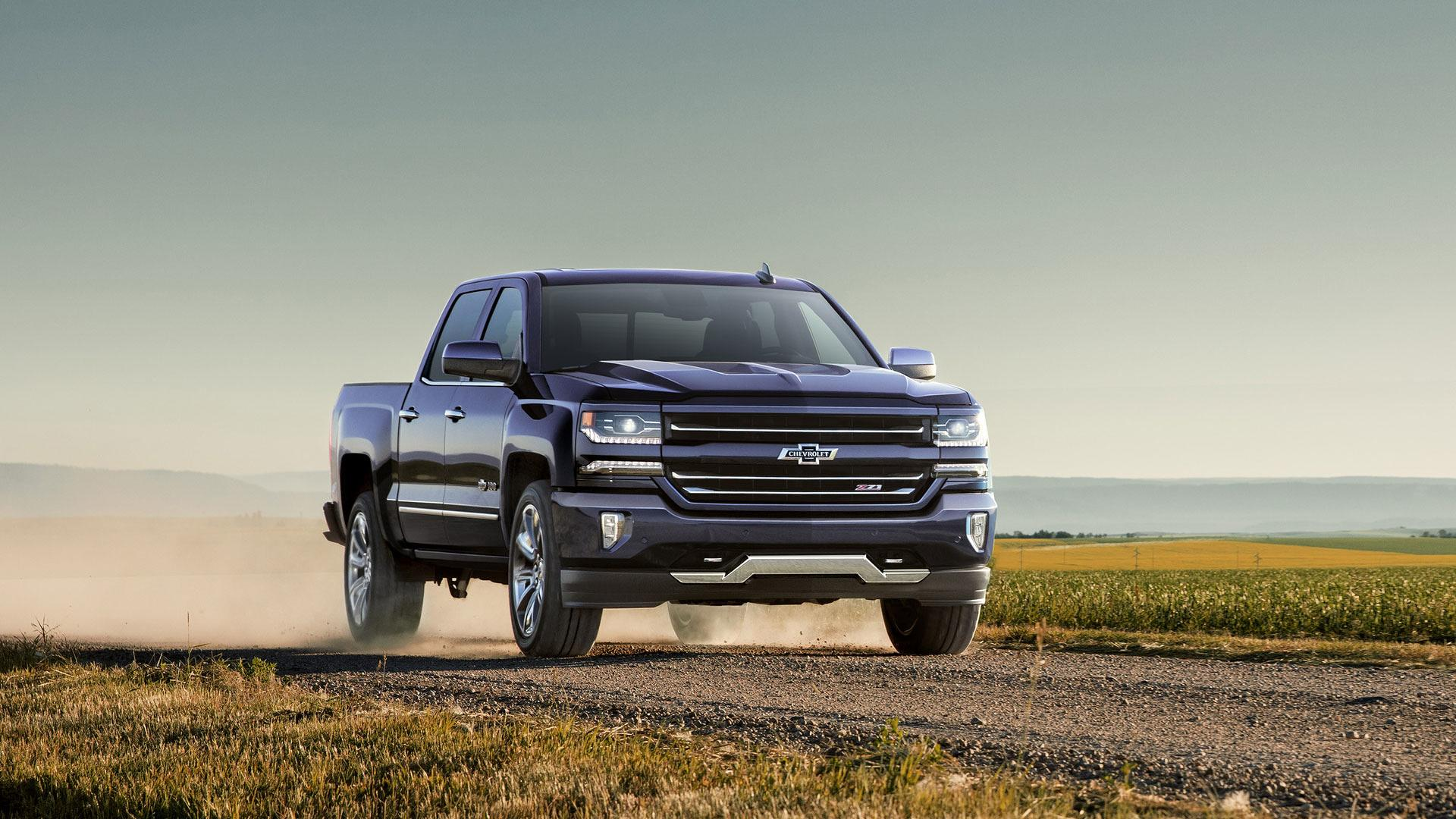 "2018 Centennial Edition Silverado - The Centennial Edition Silverado includes all of the features available on the LTZ Z71 crew cab and adds the Centennial Blue exterior paint color, front and rear heritage bowties, 100 year door badges, spray-in bedliner with heritage bowtie emblems and accessory floor liners with heritage bowtie emblems. The Centennial Edition also adds 22"" painted wheels with chrome inserts, 22"" all-terrain tires, chrome tow hooks and a chrome bowtie on the steering wheel."
