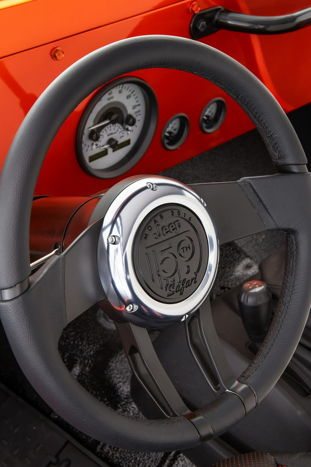 The center of the custom steering wheel, stamped with the special 50th Anniversary Moab Easter Jeep Safari logo unveiled by the Jeep brand earlier this year, reveals the Jeep CJ66's Moab-inspired origins.