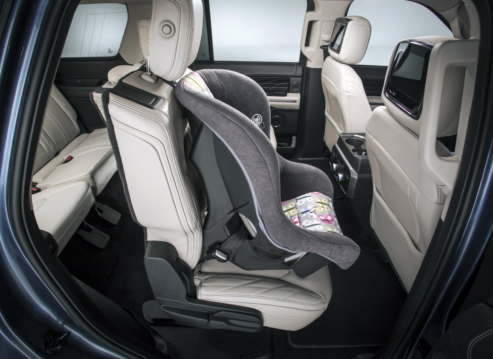Second-row seats in the all-new Ford Expedition feature tip-and-slide architecture that enables passengers to access the third row without having to uninstall a child seat mounted in the second row.
