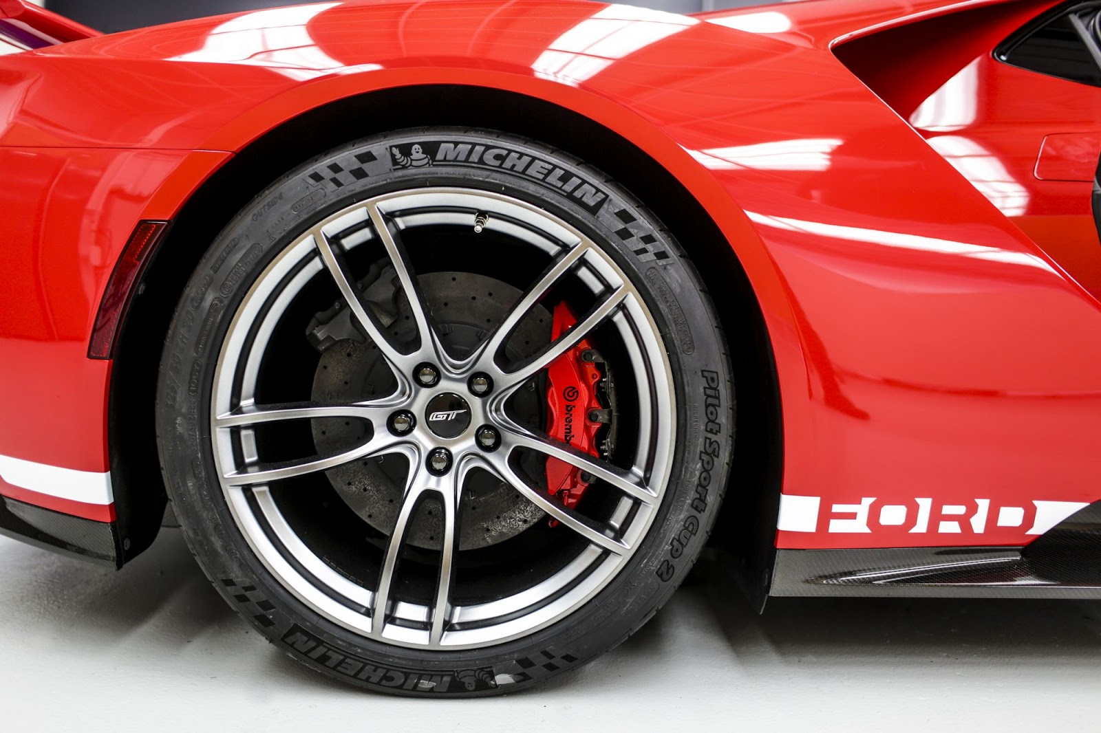 Ford GT '67 Heritage edition with unique red-and-white-stripe livery celebrates 1967 Le Mans-winning GT40 Mark IV race car driven by all-American team of Dan Gurney and A.J. Foyt