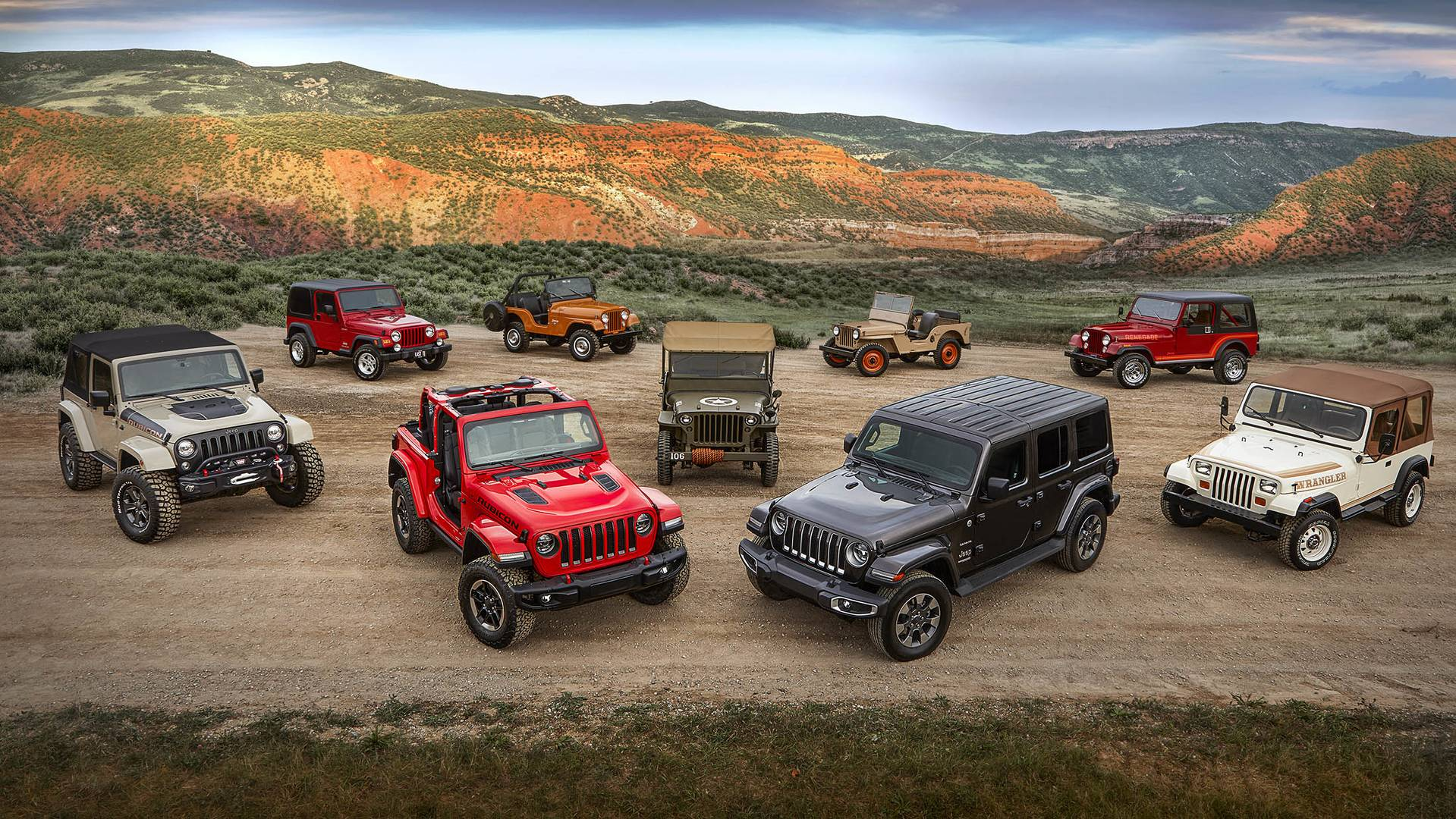 All-new 2018 Jeep® Wrangler Rubicon and Sahara with various historical Wrangler vehicles