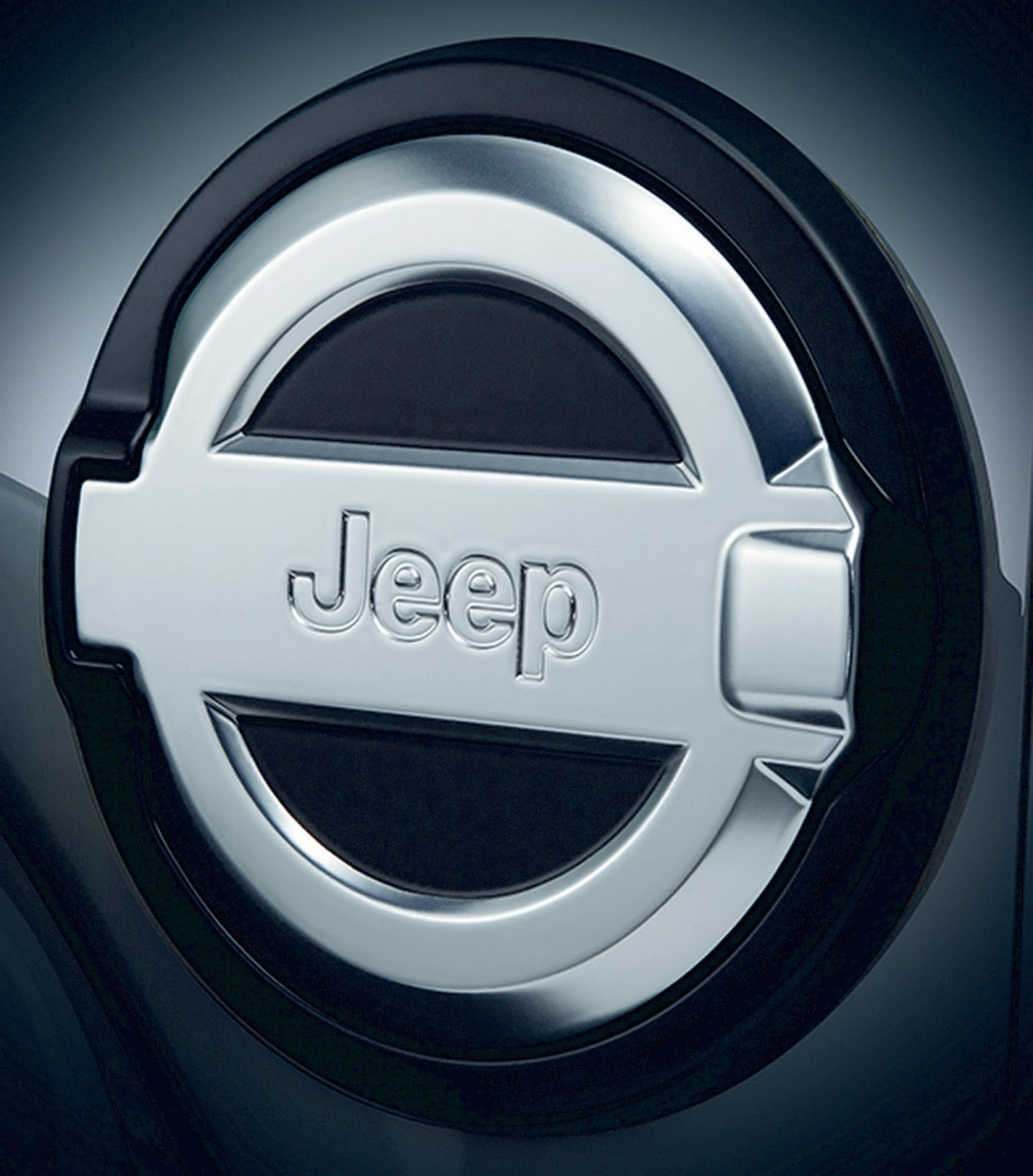 Mopar fuel doors for the all-new Jeep® Wrangler are available in brushed aluminum (pictured) as well as satin black finish, and incorporate styling cues of the all-new Wrangler.