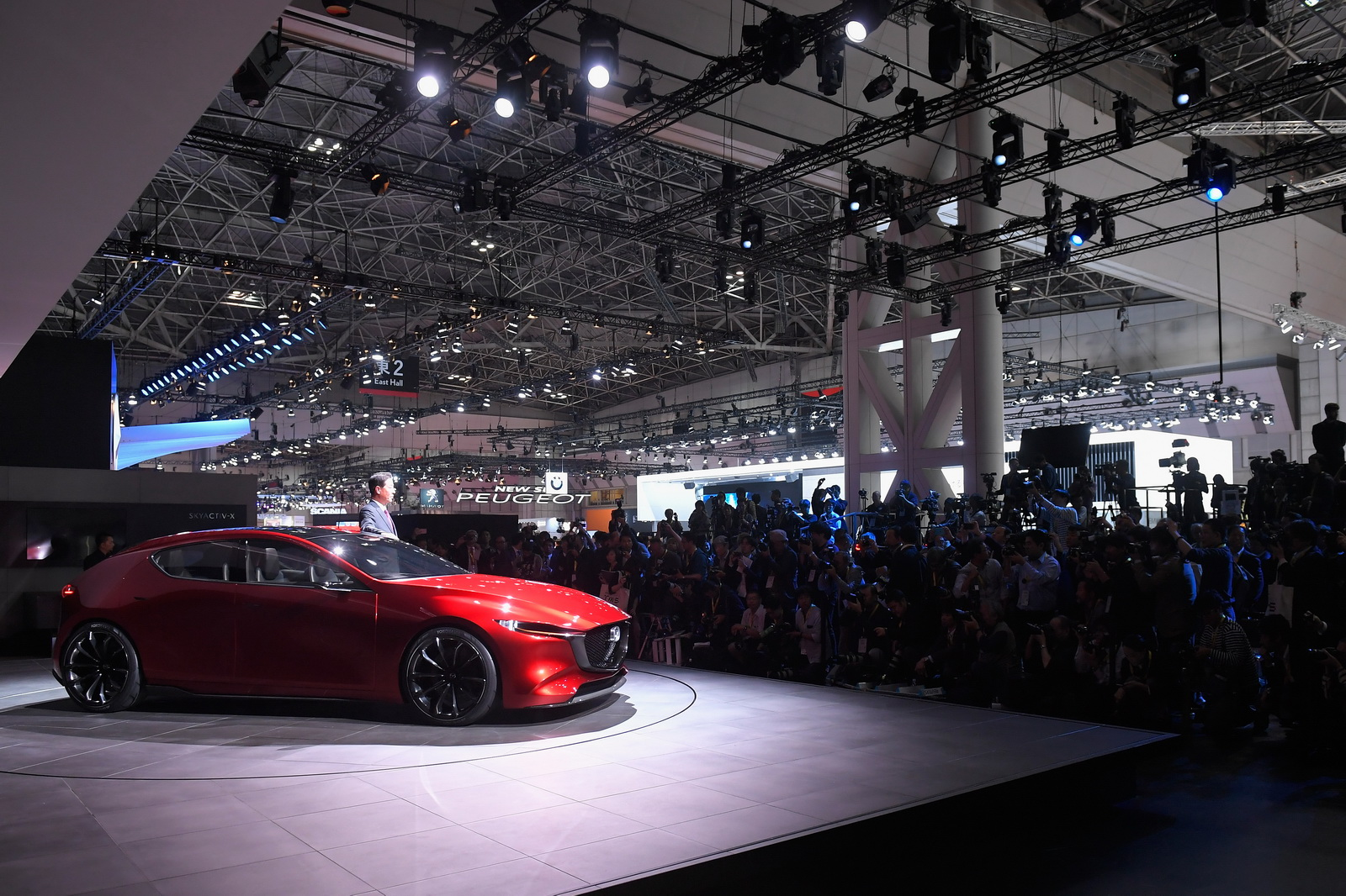 TOKYO, JAPAN - OCTOBER 25:  Mazda Motor Co CEO Masamichi Kogai poses with Mazda Kai Concept during a press conference at the Mazda Motor Co booth during the Tokyo Motor Show at Tokyo Big Sight on October 25, 2017 in Tokyo, Japan.  (Photo by Koki Nagahama/Getty Images for Mazda Motor Co) *** Local Caption *** Masamichi Kogai