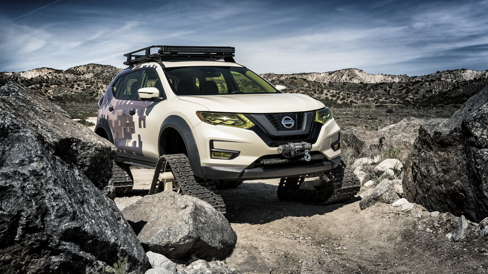 The Nissan Rogue Trail Warrior adds a new dimension to family adventures with its snow/sand tracks, gear basket, winch and camo paint. The special one-off project vehicle is one of several unique takes on Nissan's best-selling Rogue crossover created exclusively for the 2017 New York auto show.