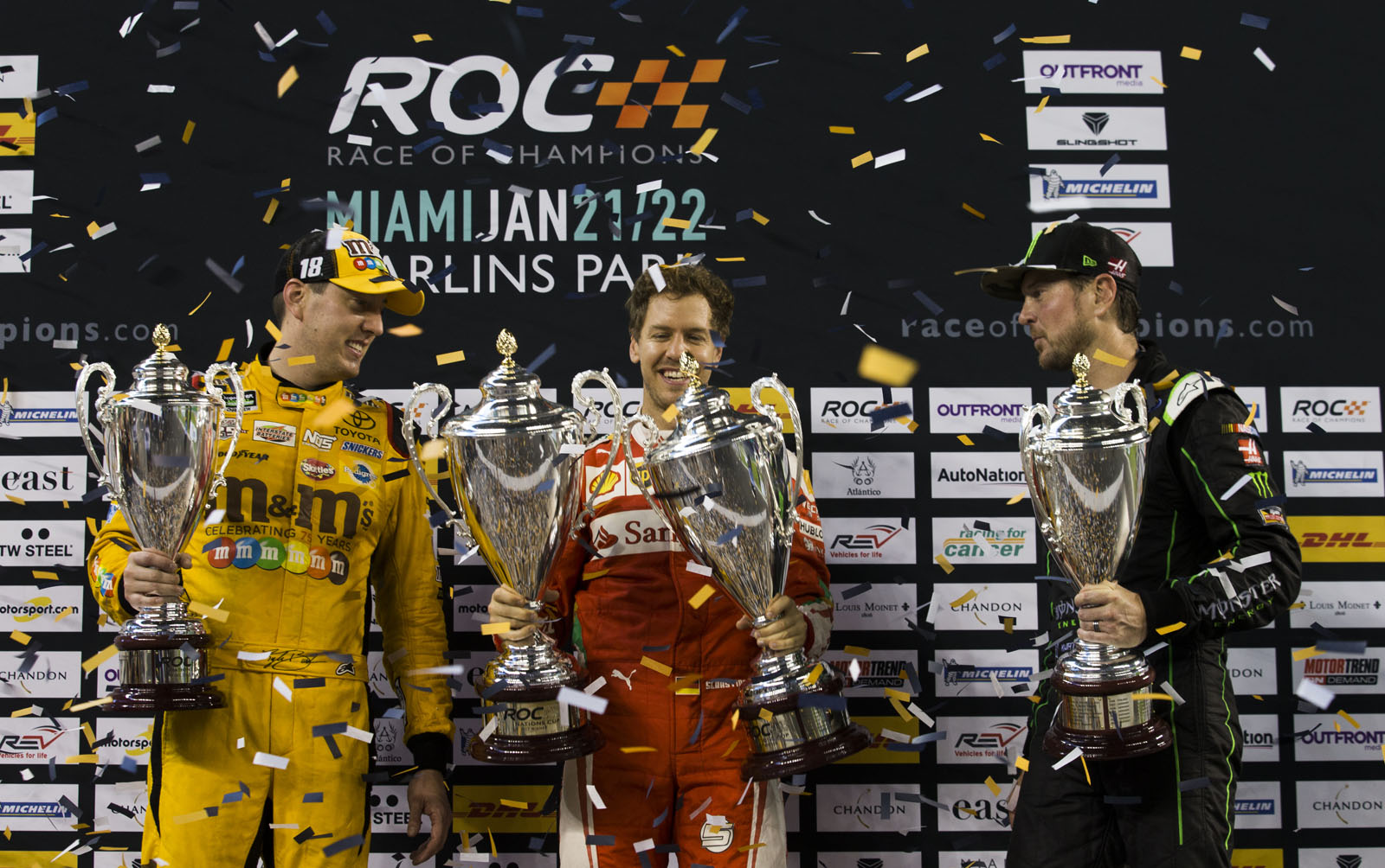 Team Germany Sebastian Vettel (GER) celebrates his win with runners up Team USA NASCAR Kyle Busch (USA) and Kurt Busch (USA) during the ROC Nations Cup on Sunday 22 January 2017 at Marlins Park, Miami, Florida, USA