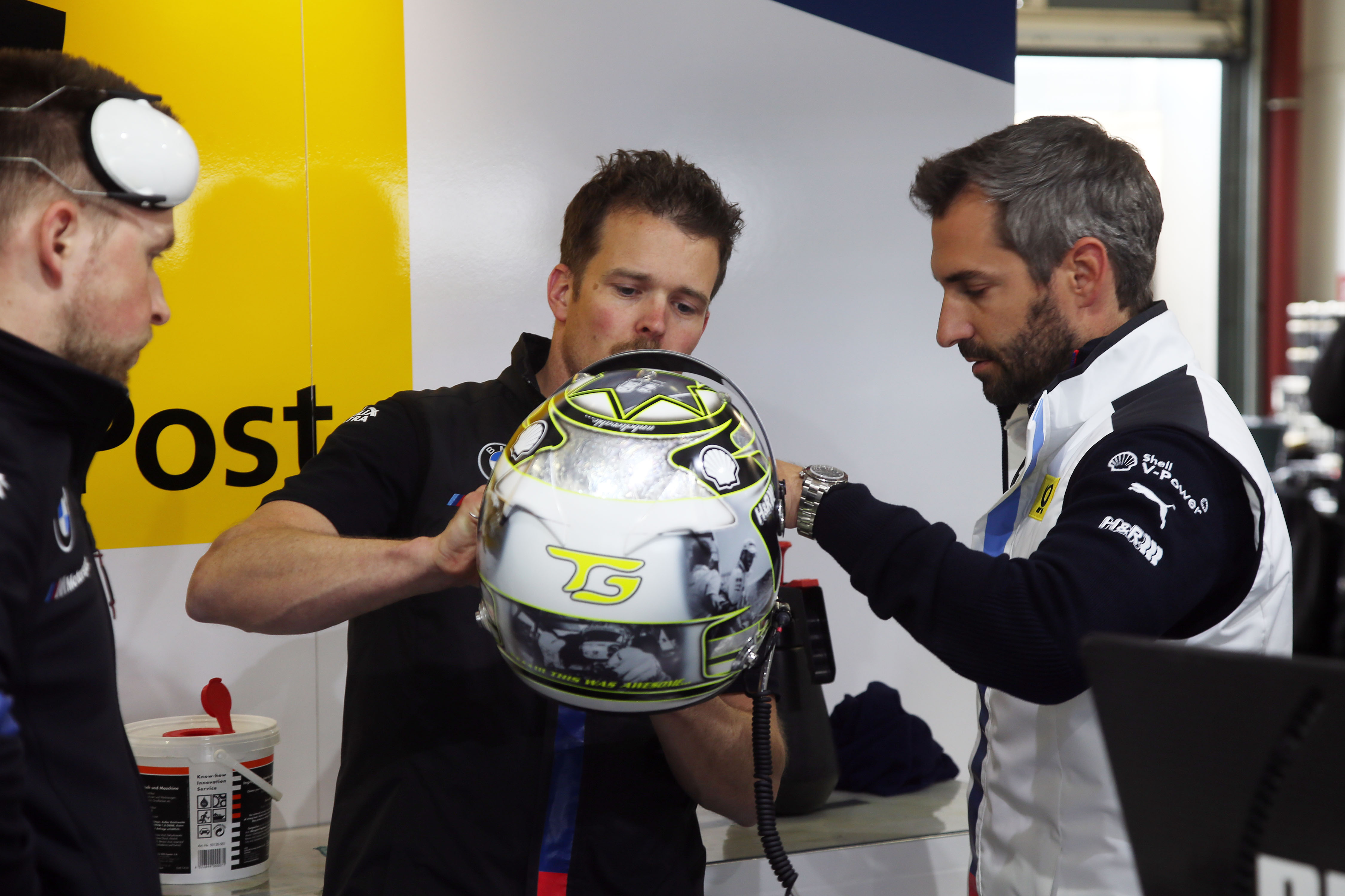 "Lausitzring (GER) 18th May 2018. BMW Motorsport, BMW Team RMR Mechanics and Timo Glock (GER) with special edition helmet ""Hockenheim 2018"" for charity."