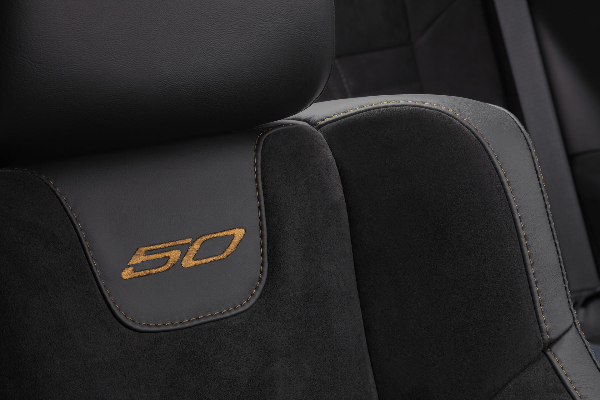 "Black, heated and ventilated Nappa leather and Alcantara suede performance seats feature Sepia accent stitching and embroidered ""50"" logo seat backs on Challenger 50th Anniversary Edition models."