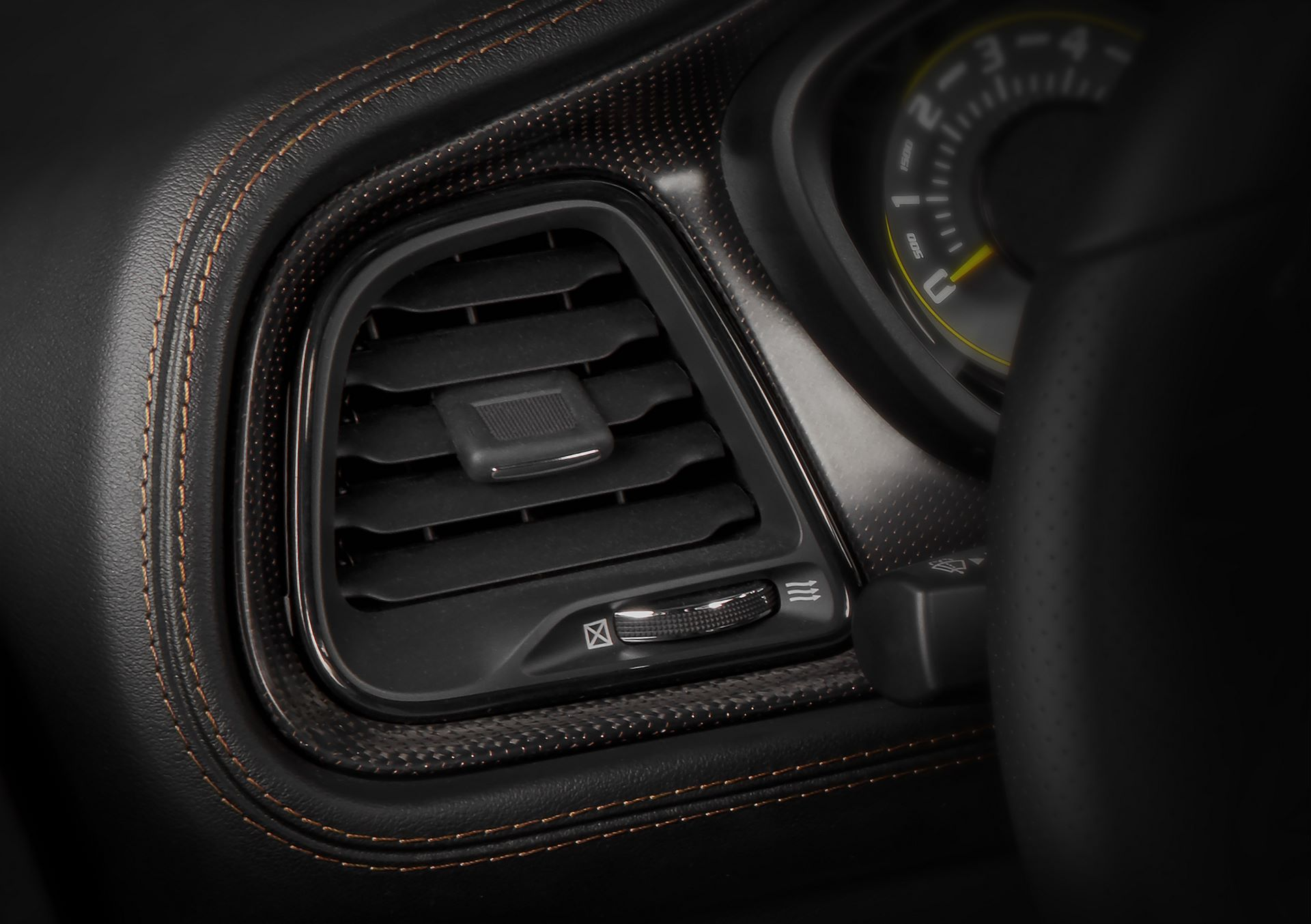 Challenger 50th Anniversary Edition models receive a real carbon fiber IP and console bezels with a copper weave.
