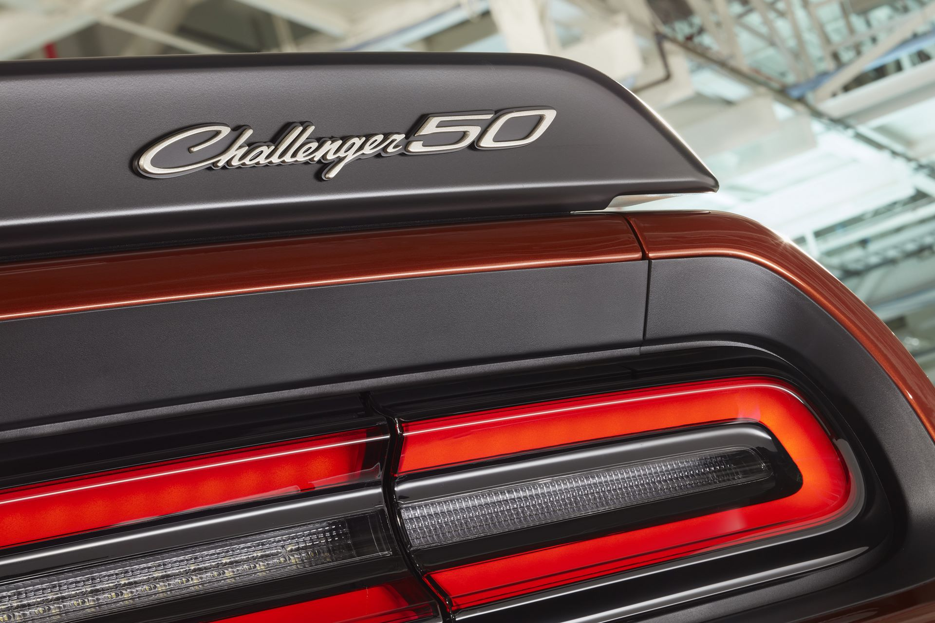 "Challenger 50th Anniversary logo badges appear on the grille and spoiler in new ""Gold School"" finish on Challenger 50th Anniversary Edition models."