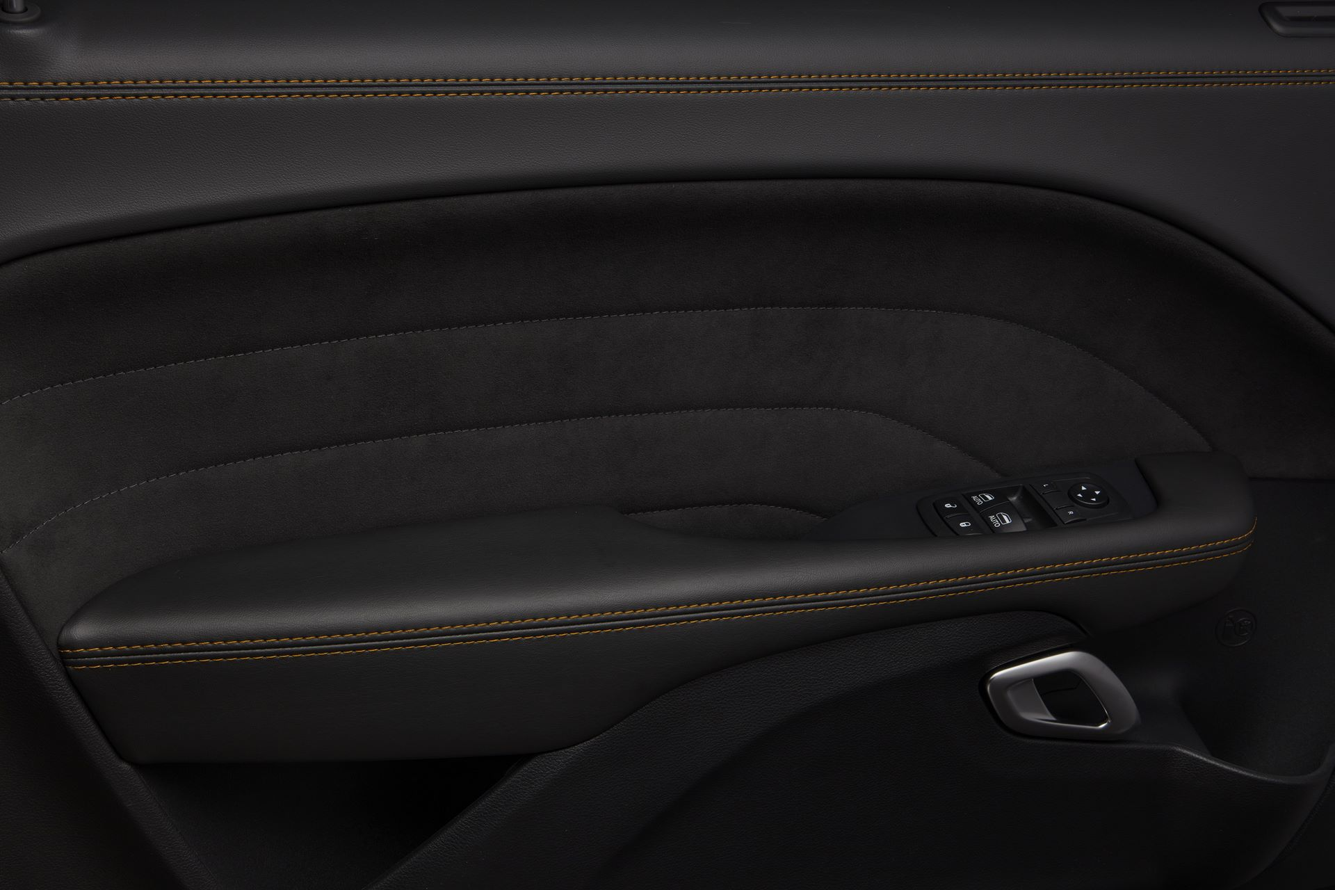 Alcantara door bolsters feature a unique accent stitch, creating a premium cockpit feel that is unique to the 50th Anniversary Edition.