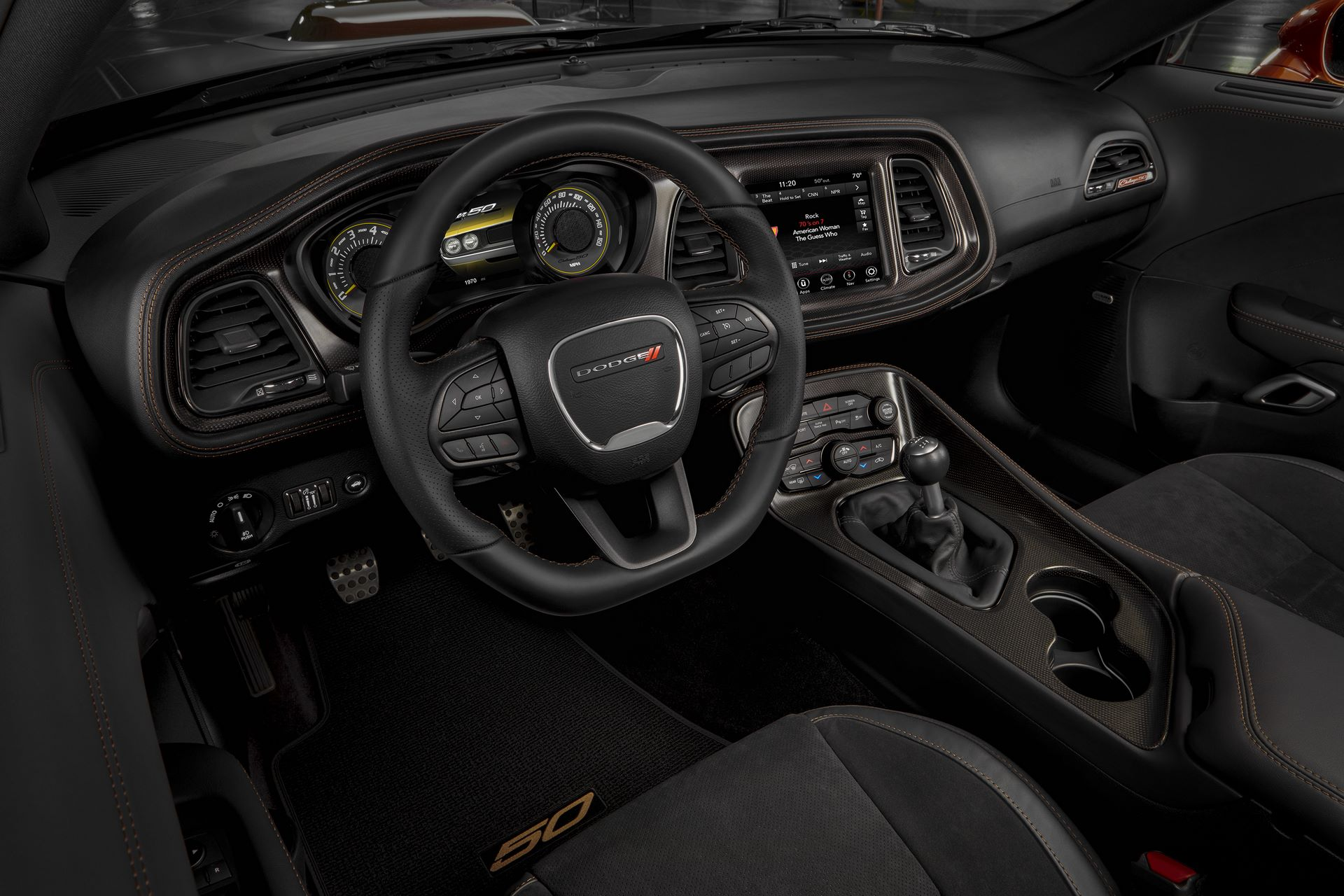 From the steering wheel to the instrument panel, startup screens, gauge faces, seat backs, door bolsters and floor mats, the 50th Anniversary theme extends into the Challenger's athletic interior.