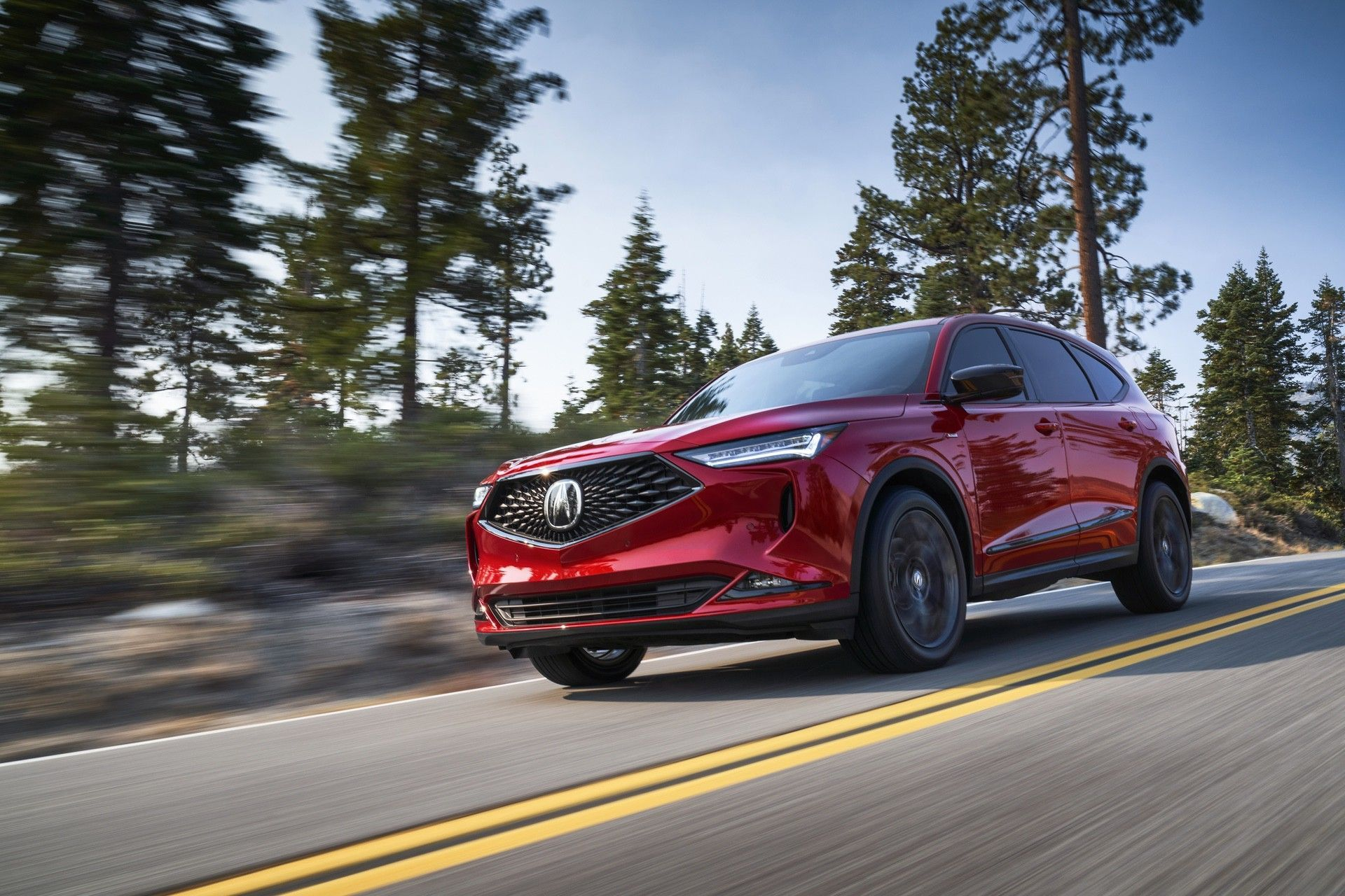 2022 MDX SH-AWD A-Spec Performance Red Pearl 3/4 Front Passenger Exterior running back road