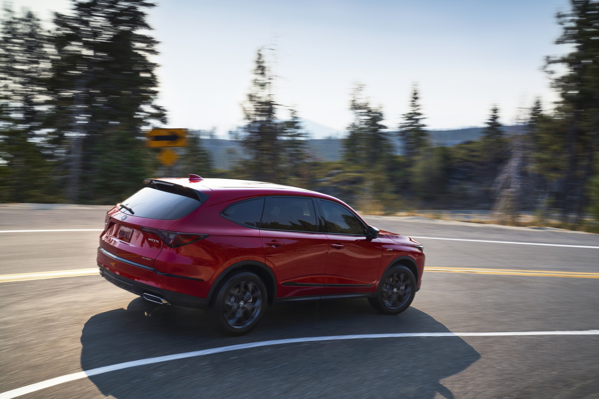 2022 MDX SH-AWD A-Spec Performance Red Pearl 3/4 Front Driver Exterior running back road