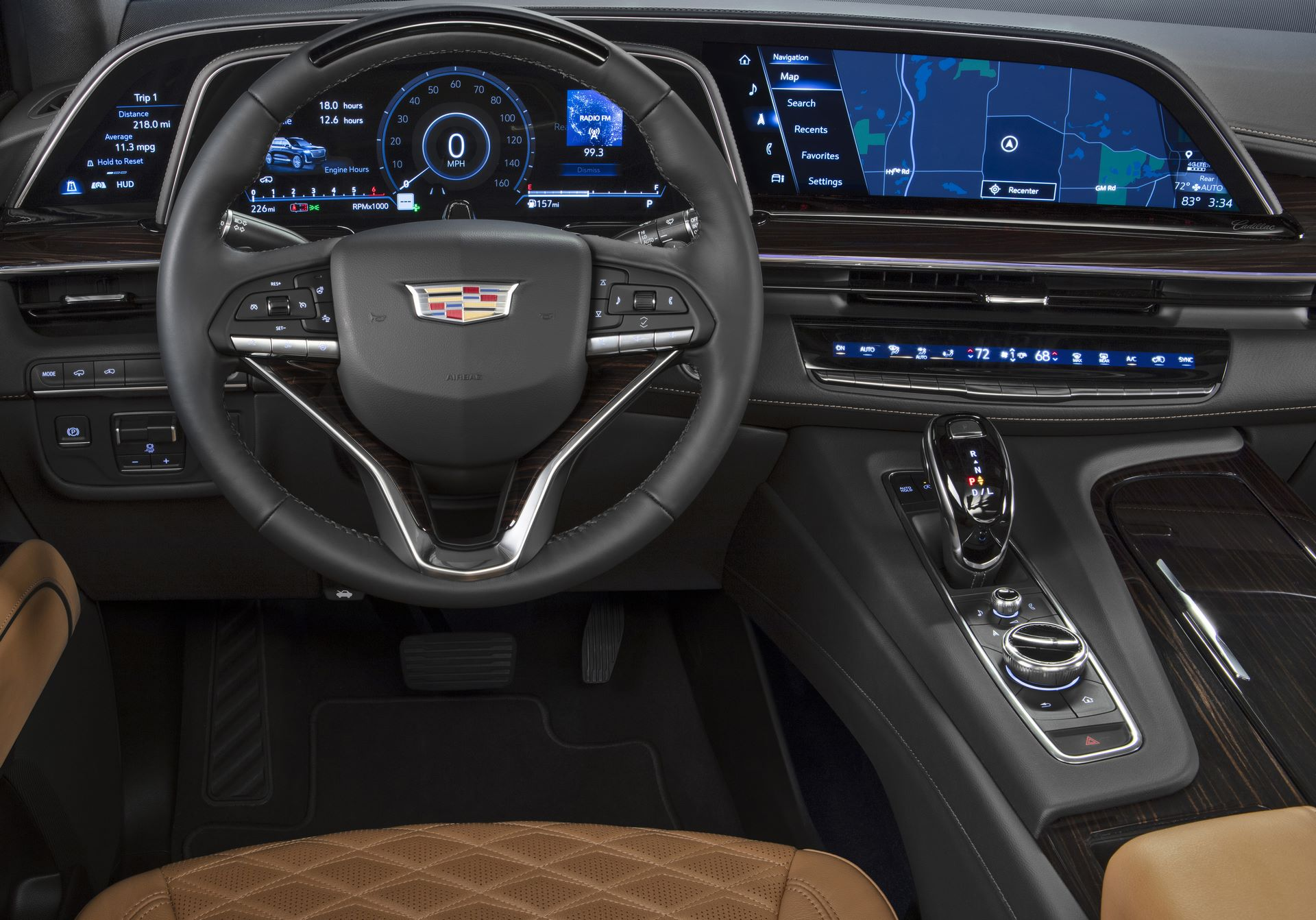 "The 2021 Cadillac Escalade showcases the first curved OLED in the industry with 38"" of total diagonal display. It consists of a 7.2-in. driver information display, a 14.2-in unit behind the steering wheel, and a 16.9 –in center display."