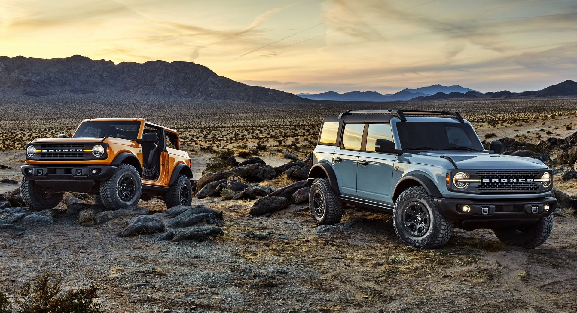 Pre-production versions of the 2021 Bronco, shown here, include Bronco two-door in Cyber Orange Metallic Tri-Coat and Bronco four-door in Cactus Gray.