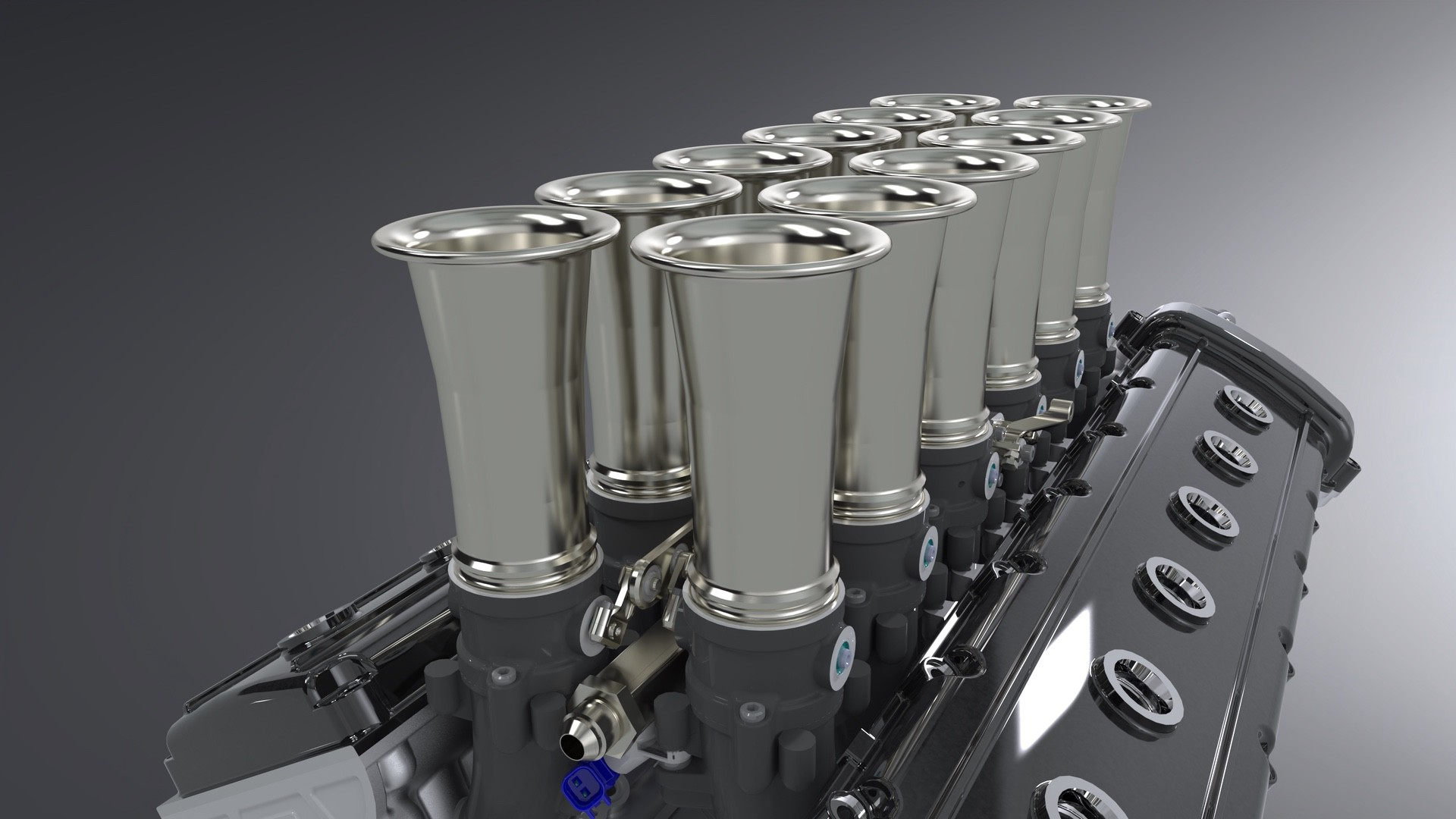 4.-GTO-Engineering-Squalo-V12-engine-close-up-trumpets-covers-on-dark-background