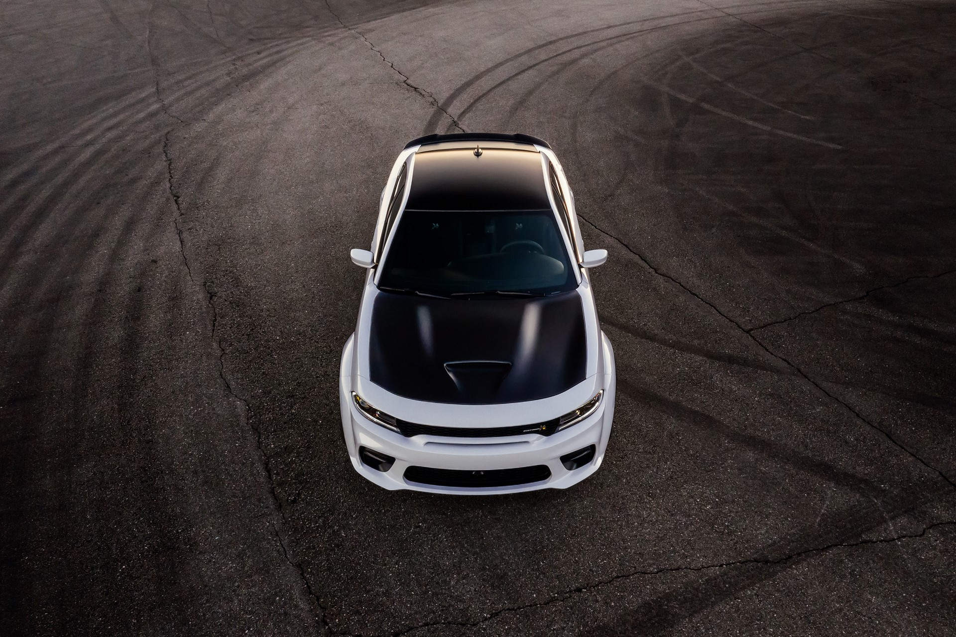 The 2020 Dodge Charger Scat Pack Widebody shown with available Satin Black painted hood, roof, deck lid and spoiler