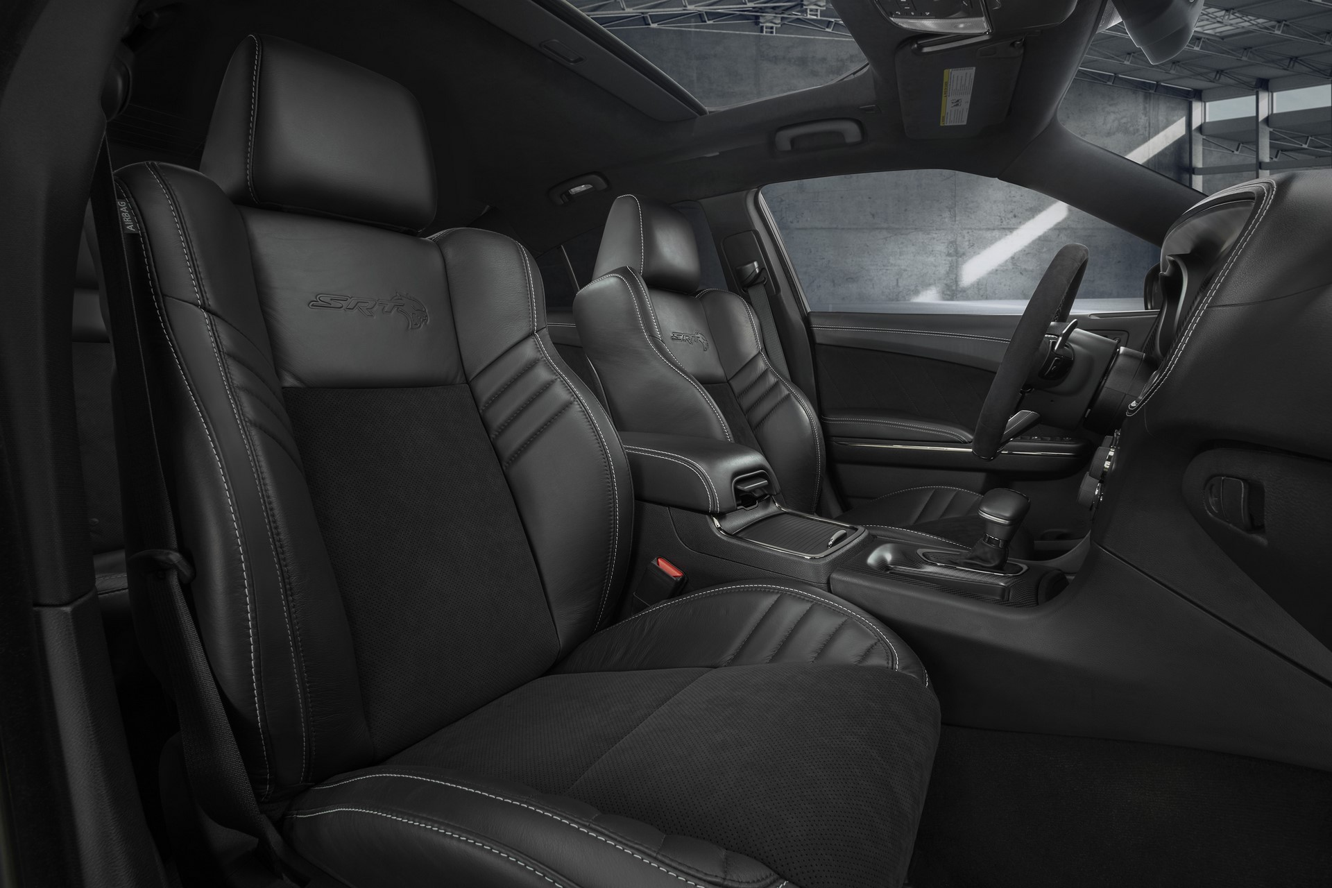 The race-inspired interior of the Dodge Charger SRT Hellcat Widebody features standard heated and ventilated Laguna leather front seats with embossed Hellcat logo - available interior color combinations include Black, Black/Sepia or Black/Demonic Red