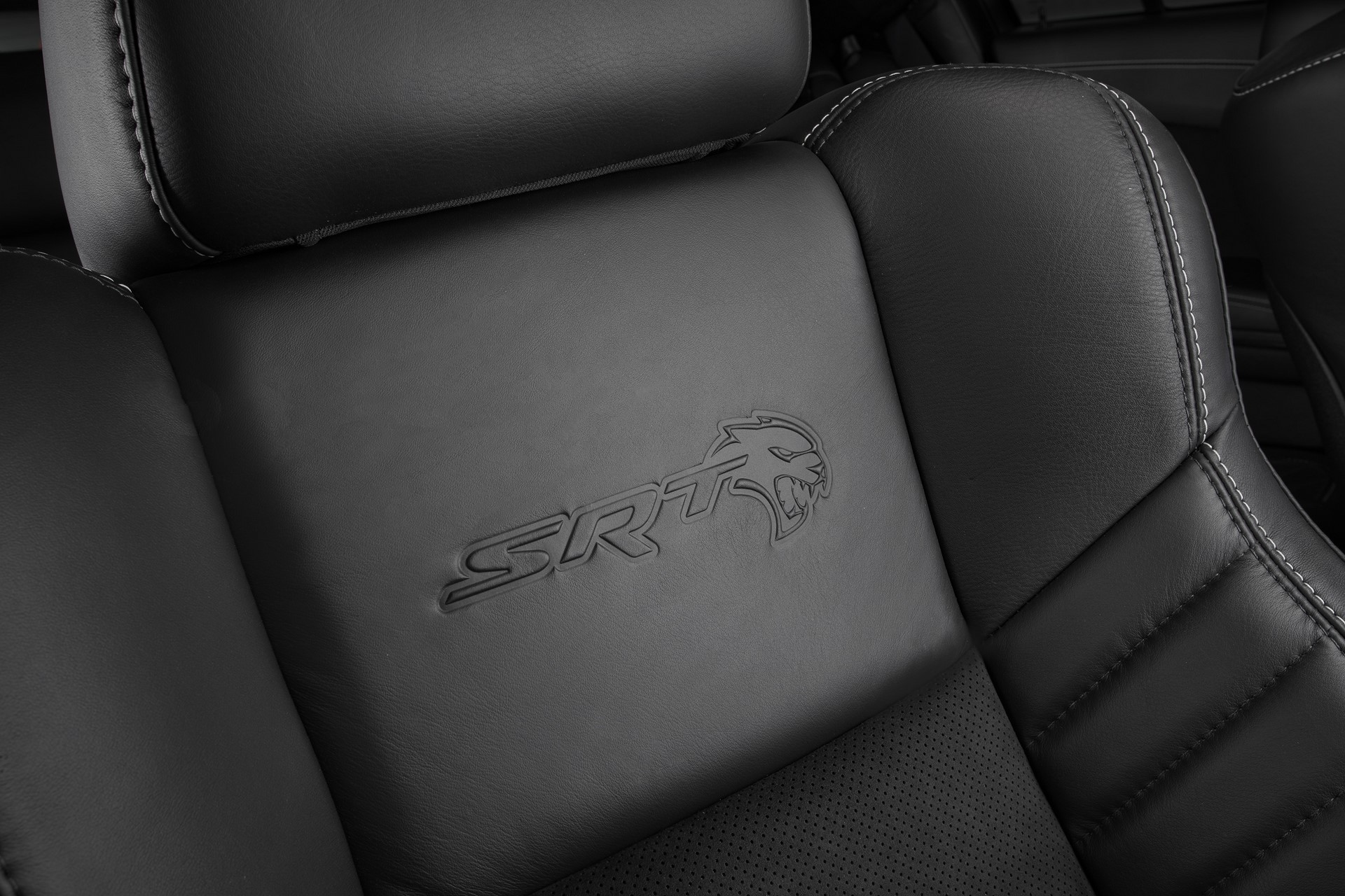 Standard heated and ventilated Laguna leather front seats feature embossed Hellcat logo in the 2020 Dodge Charger SRT Hellcat Widebody