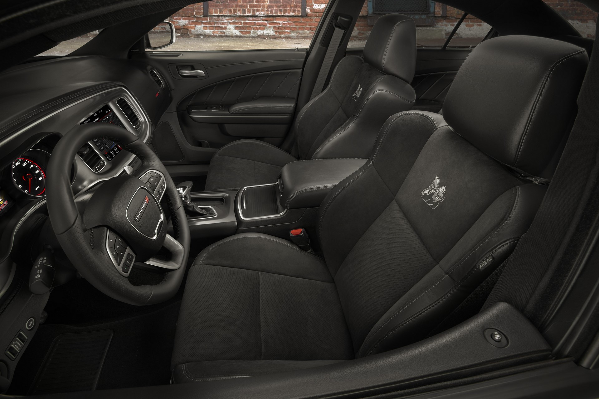 The 2020 Dodge Charger Scat Pack Widebody features an available new leather flat-bottom steering wheel.  Standard cloth performance seats feature an embroidered Scat Pack Bee logo.