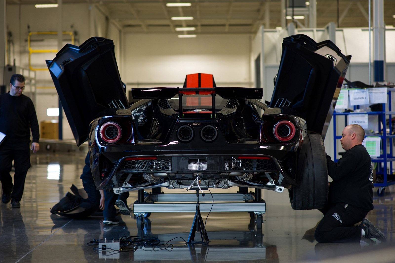 MARKHAM, Ontario, Canada, Dec. 16, 2016--The all-new Ford GT is entering the final phase of development and production has begun. One of the first Ford GTs is being driven off the line at the Multimatic assembly location with the first behind the scenes look at the assembly line for all-new Ford GT. The Ford GT is the culmination of years of Ford innovation in aerodynamics, lightweight carbon fiber construction and ultra-efficient EcoBoost engines. Pictured: Anthony Benincasa (left) and Adam Thorndyke. Photo by: Nick Busato