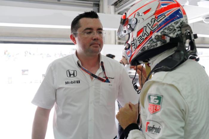 Jenson Button talks with Eric Boullier.