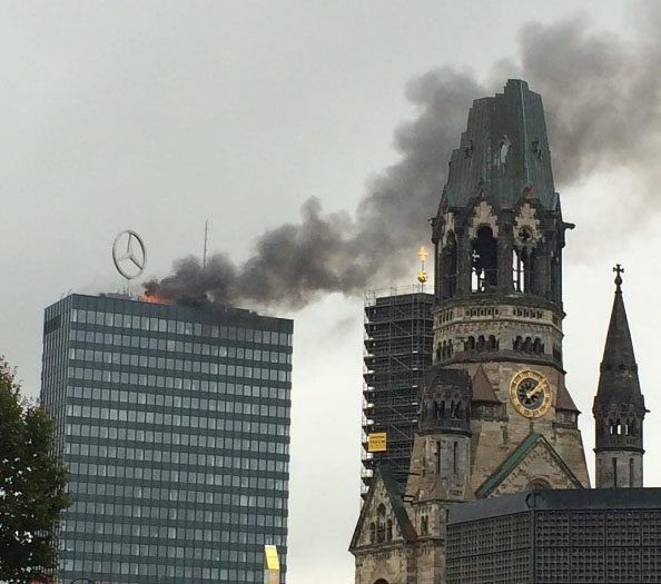 famous-berlin-tower-sporting-mercedes-benz-sign-catches-fire-112076_1